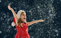 Little girl catching snowflakes Stock Photography