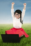 Little girl celebrate her achievement at field Stock Image