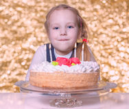 A little girl celebrates birthday Royalty Free Stock Photo