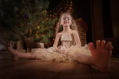 Little girl celebrates Christmas royalty free stock image