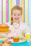 Little girl celebrates her birthday. Royalty Free Stock Photo