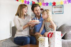 Little girl celebrating birthday party in modern white house. Royalty Free Stock Photo
