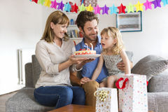 Little girl celebrating birthday party in modern white house. Stock Photo