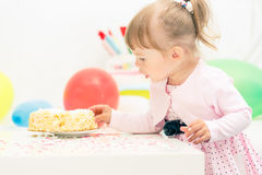 Little girl celebrating second birthday Stock Photos