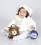 The little girl in celebratory clothes. The little girl in expectation of new year, in celebratory clothes Royalty Free Stock Photo