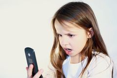 Little girl with cell phone. Royalty Free Stock Photos