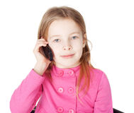 Little girl with cell phone Royalty Free Stock Photos