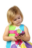 Little girl with cell phone on gray Royalty Free Stock Image