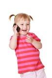 Little girl with cellphone Stock Photos