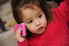 Little girl with a cellphone Stock Photos