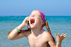 A little girl with cellular phone Royalty Free Stock Photos