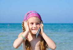 A little girl with cellular phone Royalty Free Stock Photo