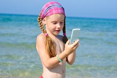 A little girl with cellular phone Stock Images