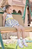 Little girl on chain swing Royalty Free Stock Images