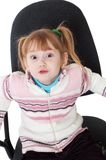 Little girl in chair Stock Photography