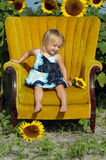 Little girl in chair Royalty Free Stock Image