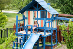 Little girl in chair on outdoor playset Royalty Free Stock Images