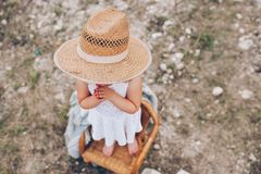 little girl in a chair outdoors Stock Photo