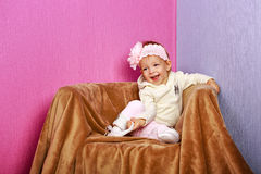 Little girl in the chair Stock Image