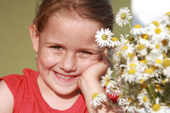 Little girl with chamomile royalty free stock photography