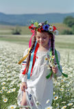 Little girl on chamomile field Stock Photo