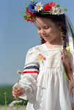 Little girl on chamomile field Royalty Free Stock Photo
