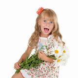 Little girl with chamomiles. Cheerful little girl with a bunch of chamomile isolated on white background stock photography