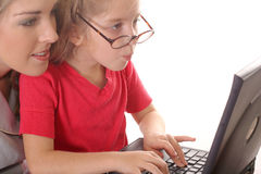 Little girl checking emails wi. Shot of a little girl checking emails with mom Royalty Free Stock Image
