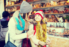 Little girl with cheerful mom buying figures and workpiece for c Stock Images