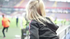 Little girl cheers for the Russian team in a football match stock video