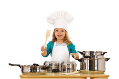 Little girl chef beating on the pots. Little girl chef banging the beat on the cooking pots - isolated Royalty Free Stock Image