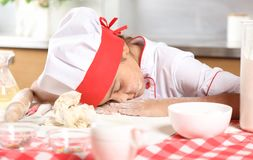 Little girl sleeping at the kitchen table royalty free stock photography