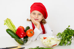 Little girl chef is going to prepare a salad isolated Stock Photos