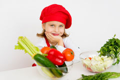 Little girl chef is going to prepare a salad isolated Royalty Free Stock Image