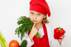 Little girl chef is going to prepare a salad isolated Stock Photo