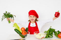 Little girl chef is going to prepare a salad isolated Stock Photography