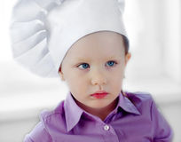 Little girl in chef hat Royalty Free Stock Photography