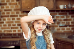 Little girl in chef hat and flour on face Royalty Free Stock Photography