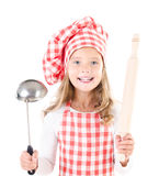 Little girl in chef hat with ladle and  rolling pin Royalty Free Stock Photo