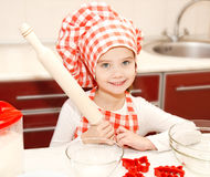 Little girl with chef hat and rolling pin is going to bake cooki Stock Photo
