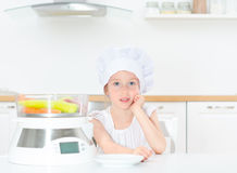 Little girl in chef hat. Stock Photography