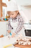 Little girl chef in the kitchen Stock Image