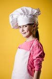 Little girl chef in uniform Royalty Free Stock Image
