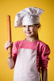 Little girl chef in uniform Royalty Free Stock Photo
