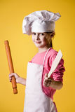 Little girl chef in uniform Royalty Free Stock Images