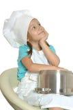 Little girl in chef uniform Stock Photos