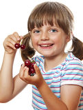 Little girl with cherries Stock Image