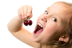 Little girl with cherries stock photos