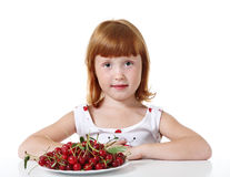 Little girl with cherry Royalty Free Stock Image