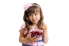 Little girl with cherry berries bowl isolated Stock Photography